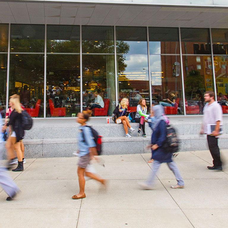 Students walking by the campus center.
