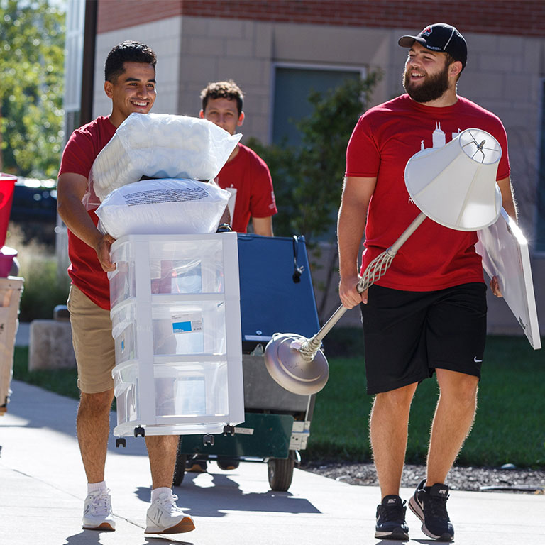 Students moving into North Hall with some of their items for their room.