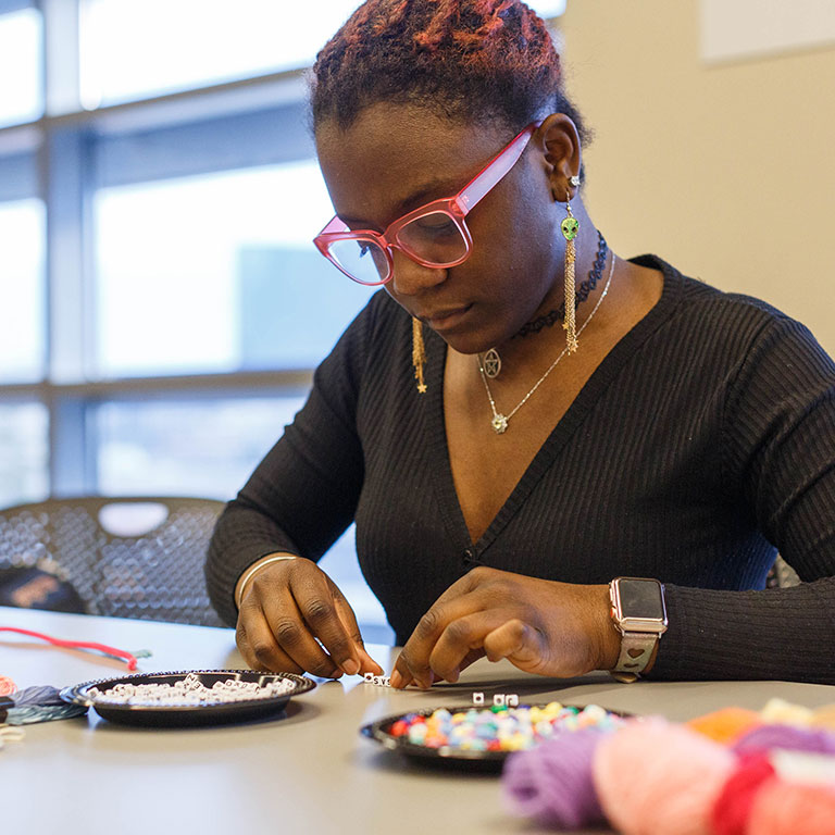 A student works on a craft project at a recent sophomore social event.