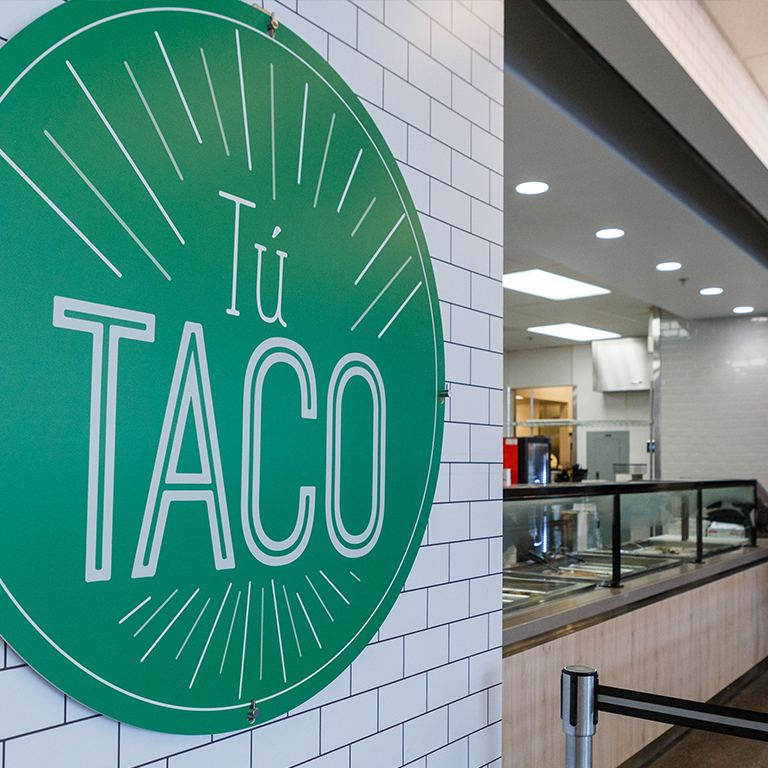 Sign for Tu Taco, one of the Student Choice food options on campus.