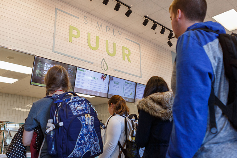 Students waiting in line at Simply PUUR.