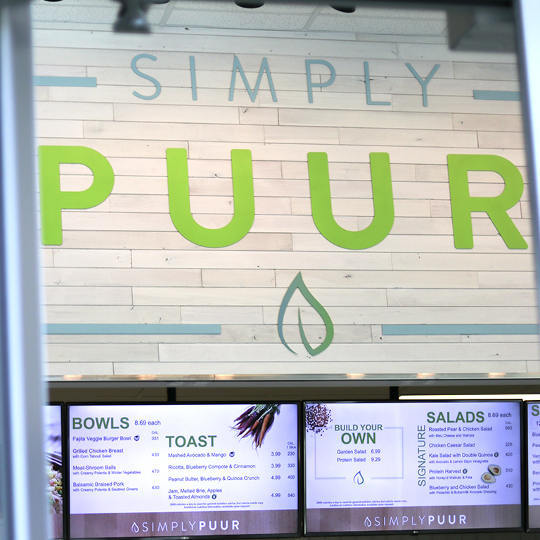 Photo of the Simply PUUR logo above the menus in the Campus Center.