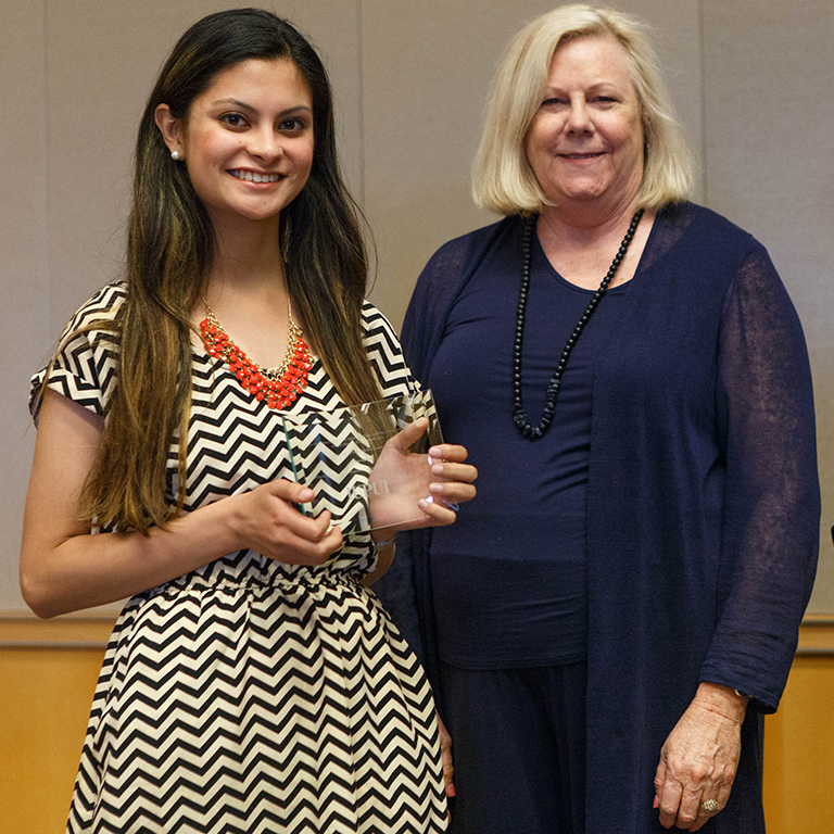Photo of a student award winner and presenter.