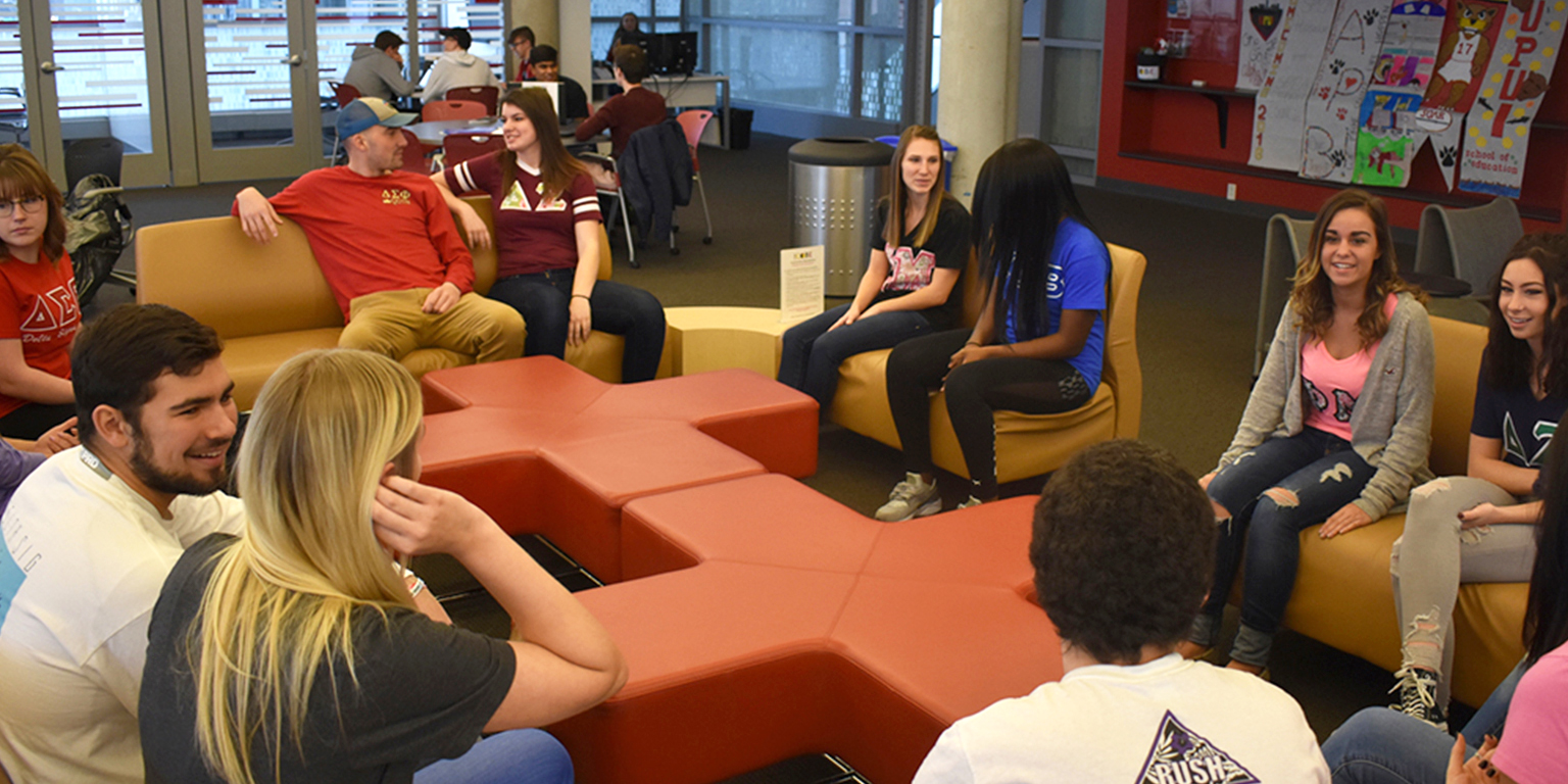 Various students socialize in the cube.