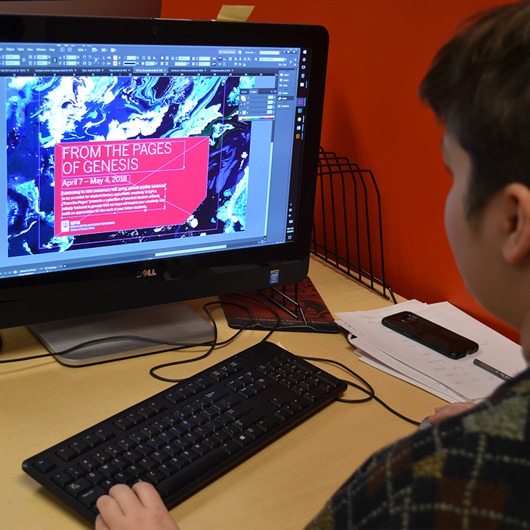 Student designer uses Adobe InDesign on a current project in the MPC.