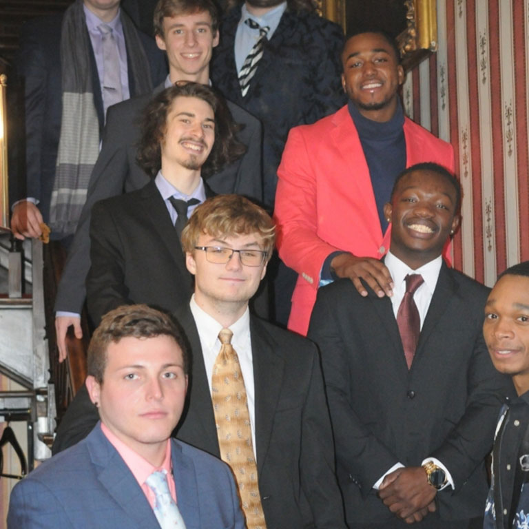 PDT members stand on a staircase for a photo.