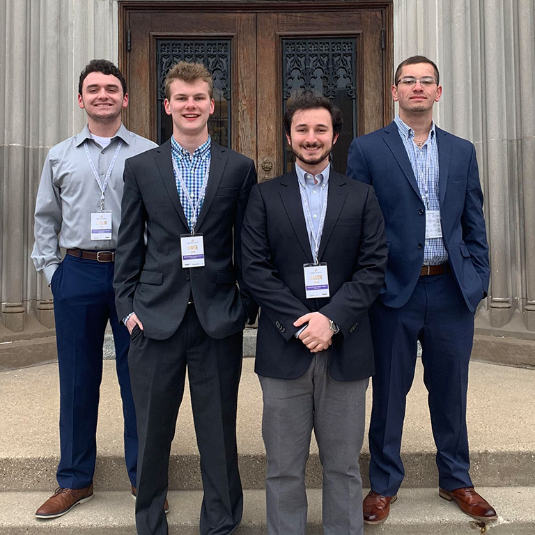 SAE members standing outside their headquarters.