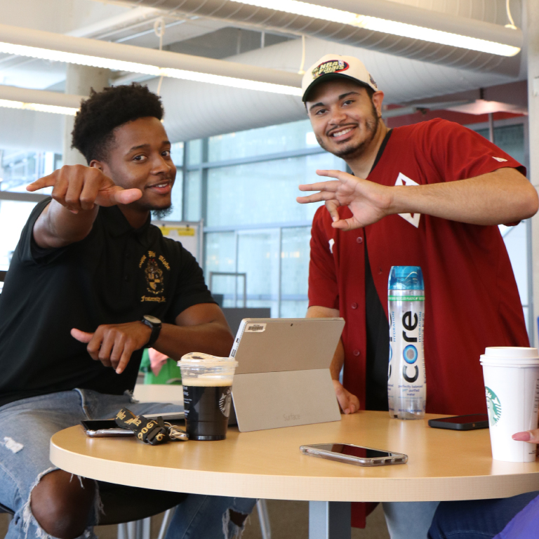 A student obtains information about student organizations at an information table.