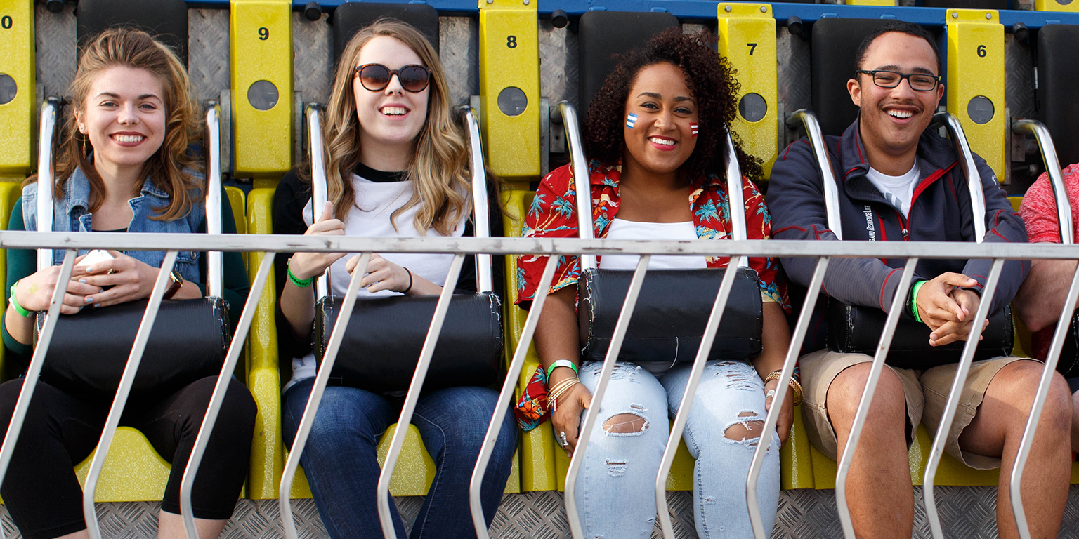 Four students on a fair ride at Jagapalooza.