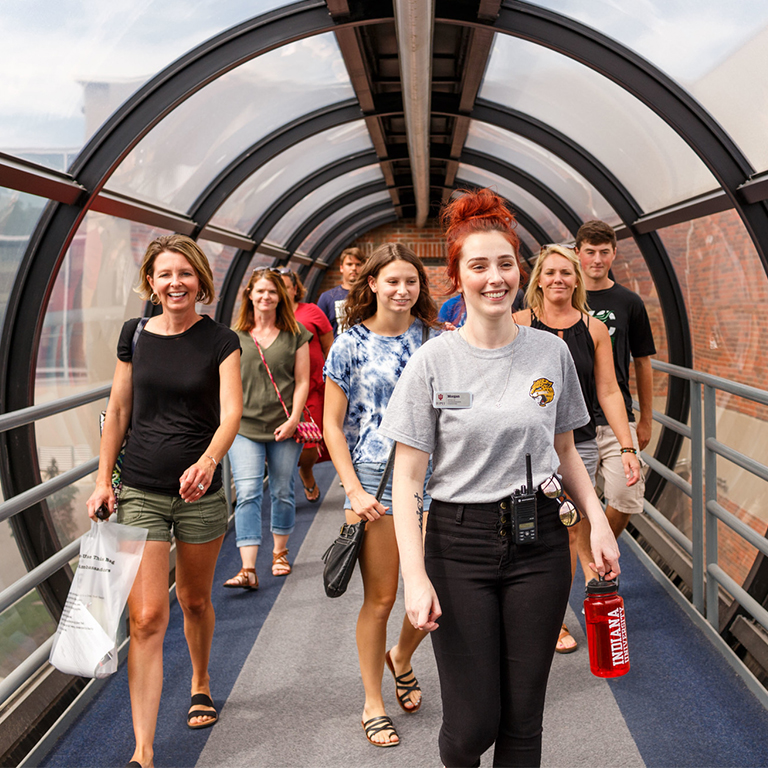 Campus tour being lead by a female student