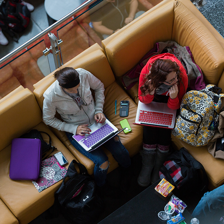 Overhead view of students in the campus center.