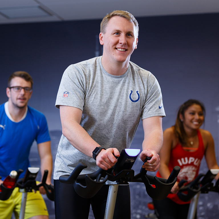 Students in a cycling class in the fitness center.