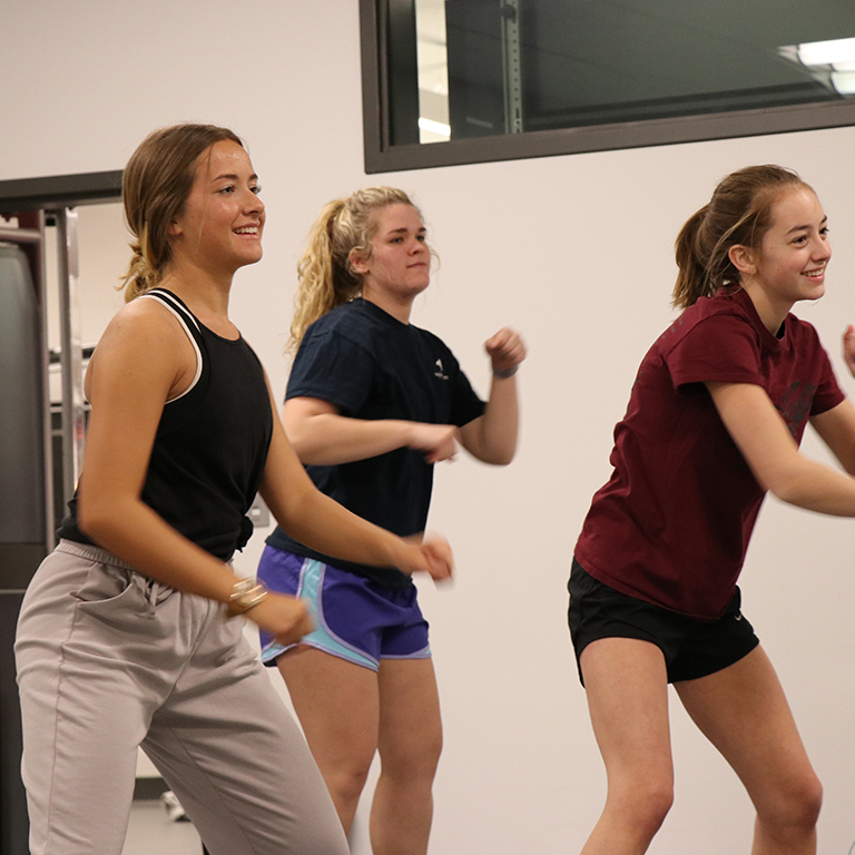 Students participate in a Turbo Kick class in the fitness center.