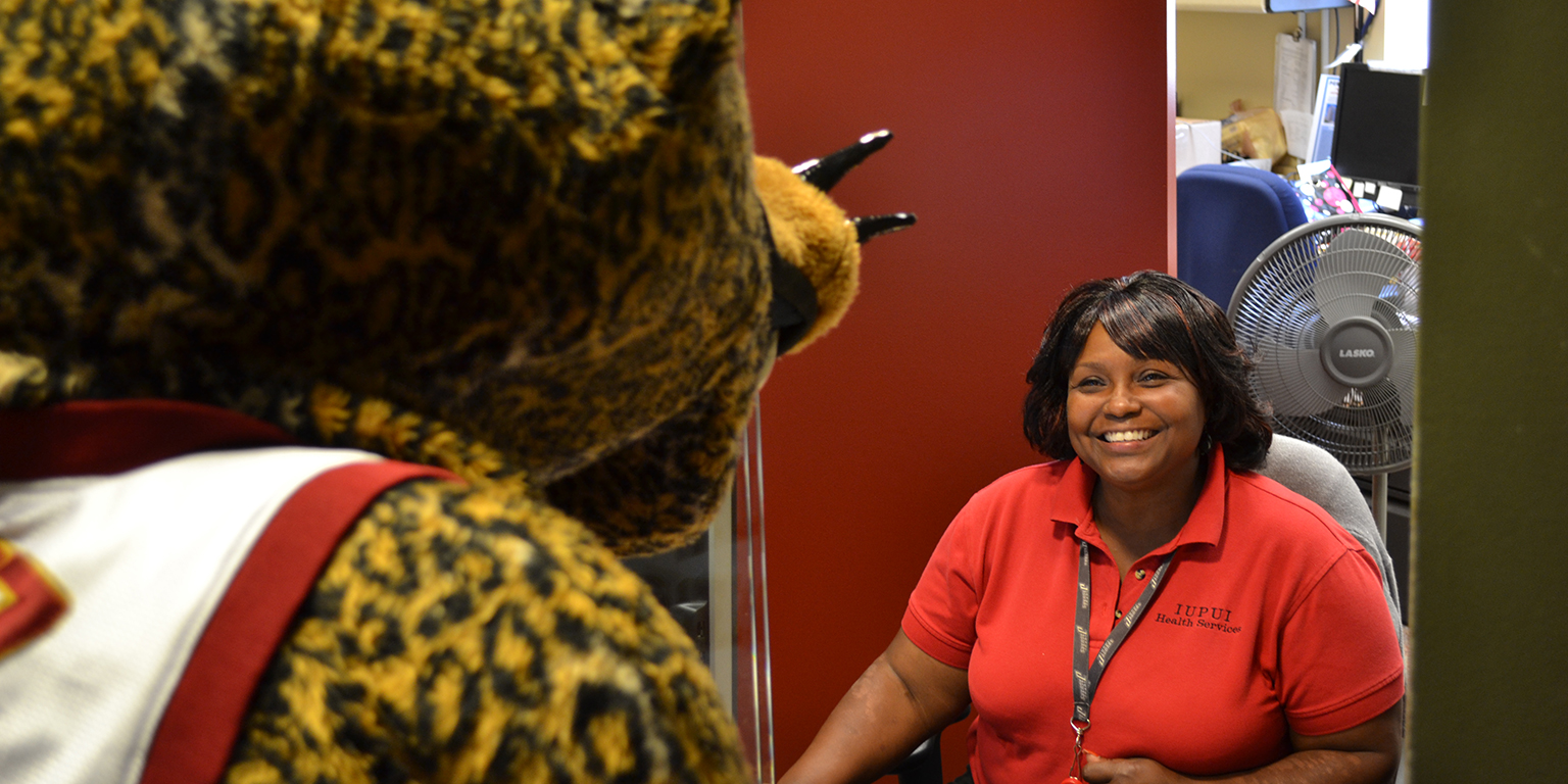 Jawz visits the front desk at student health in coleman hall.