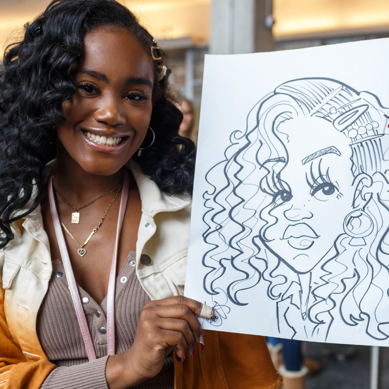 A student painting at a recent event.