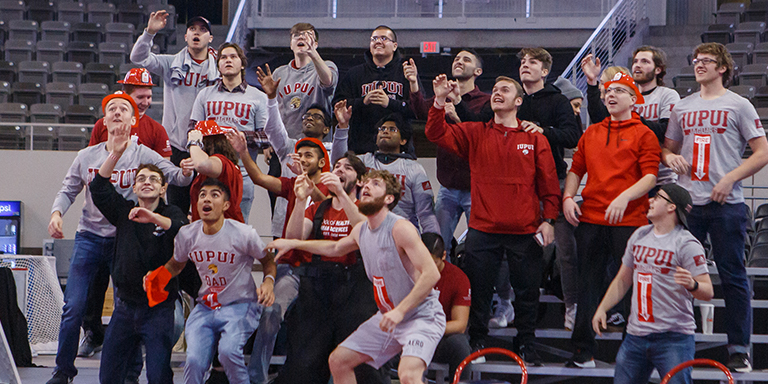 Students in the crowd at an IUPUI sporting event.